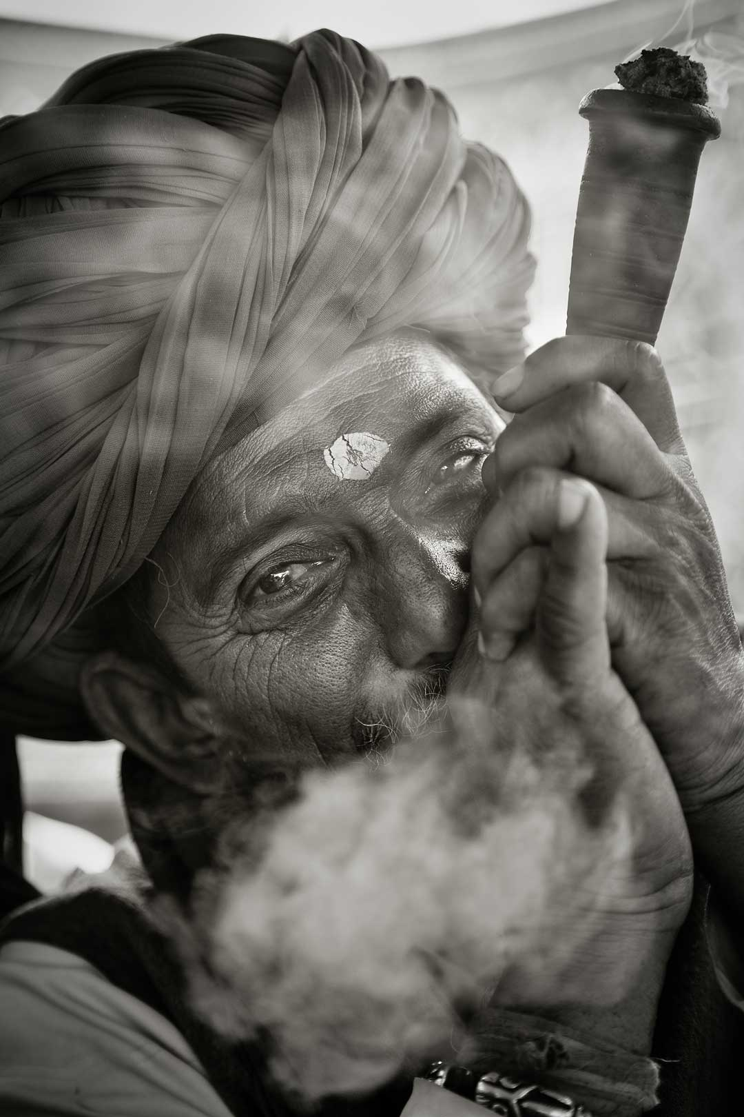 Close up of a smoker during an opium ceremony. Rajasthan, India